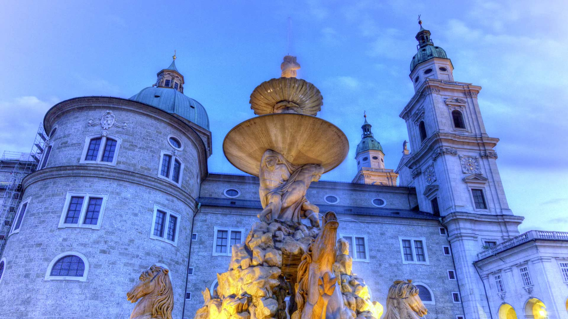 Fountain and cathedral at the Residenzplatz in Salzburg, Austria