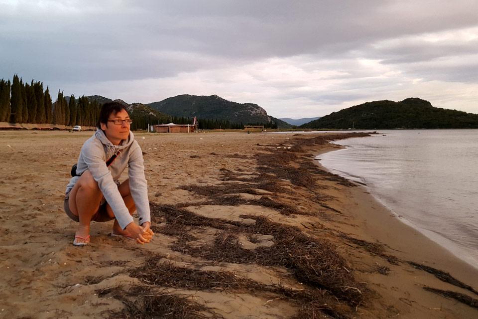 Elena thinking on the beach, Croatia